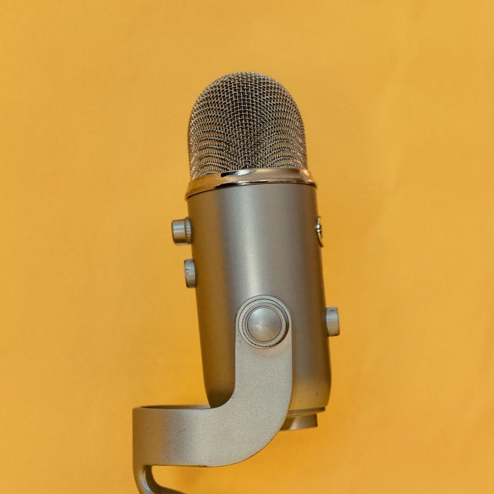 broadcasting microphone on a yellow background