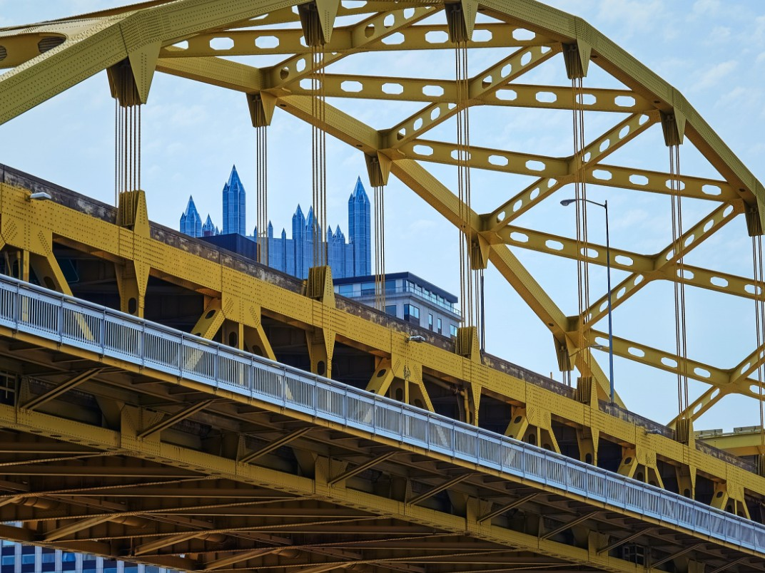 yellow pittsburgh bridge with ppg place in the background